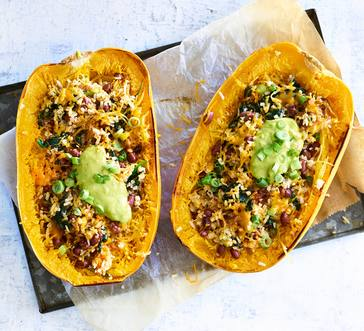 Spaghetti Squash Halves Stuffed with Spinach, Rice, and Cheese image