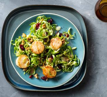 Scallops over Brussels Sprouts Salad image