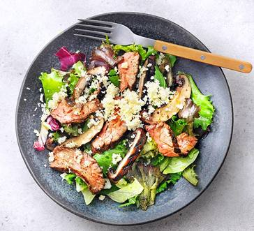 Mixed Green Salad with Grilled Steak, Grilled Mushrooms, and Pesto Dressing image
