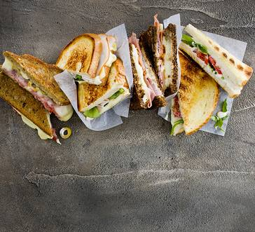 Muenster, Salami, and Olive Sandwiches image