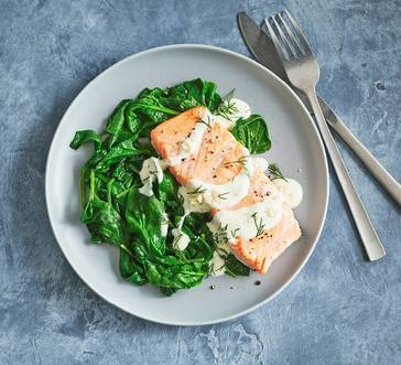 Broiled Salmon over Spinach image