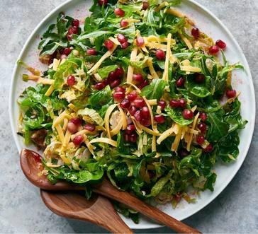 Brussels Sprout and Arugula Salad with Pomegranate Dressing image