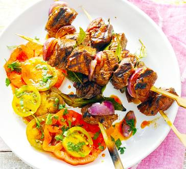 Steak Kabobs with Tomato Salad and Grilled Bread image