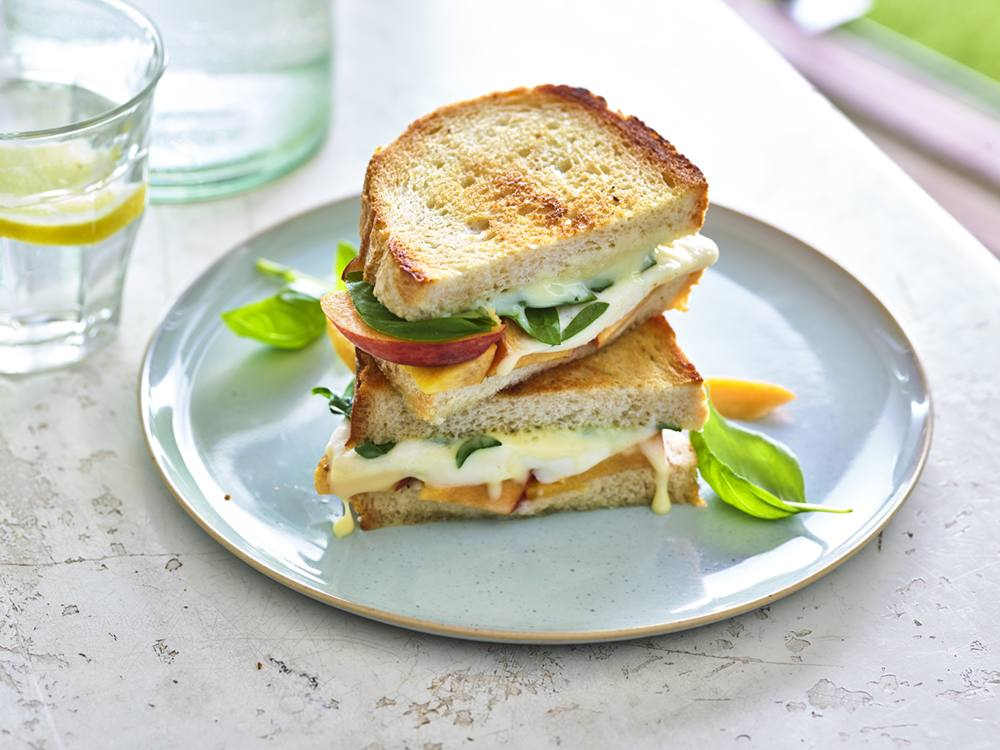 The classic tricolor Italian salad gets a summery sandwich twist with the addition of sweet peaches and bright balsamic vinegar.