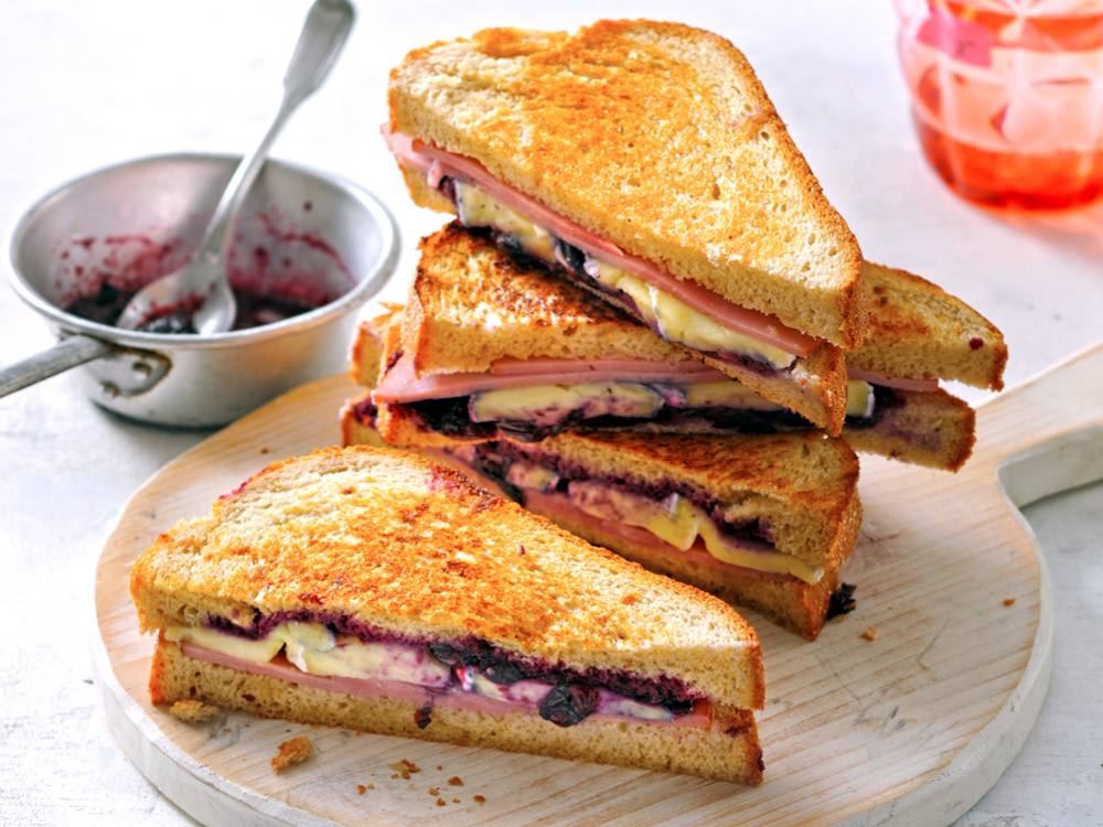 This sweet and savory sandwich features blueberries cooked into a simple jam and gooey cheese.