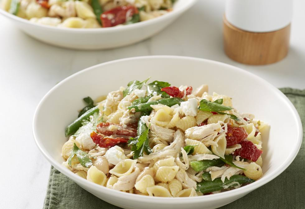 Warm chicken and bean pasta salad