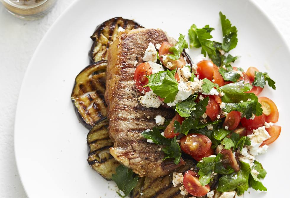 Steak with grilled eggplant, tomato and feta