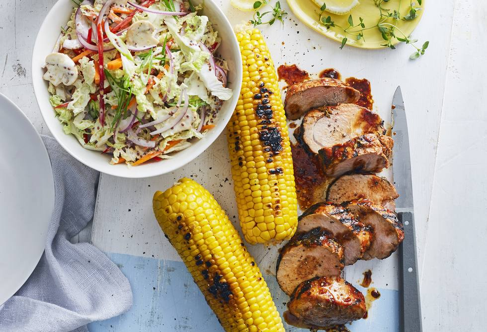 Marinated pork with corn and salad