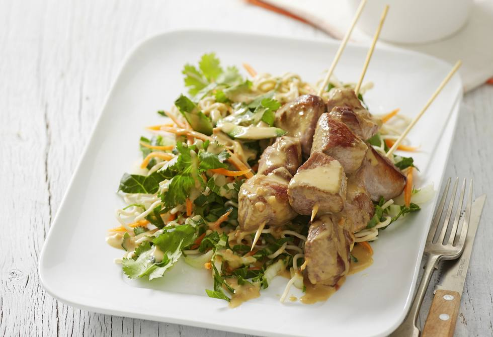 Lamb skewers with coconut and peanut curry sauce