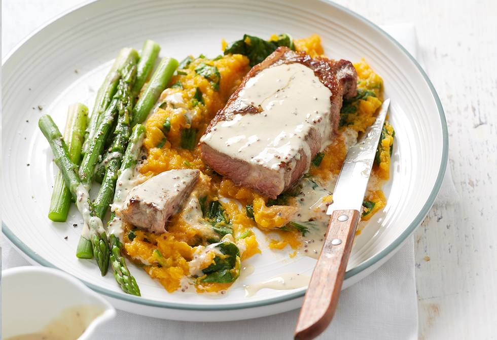 Mustard steaks with pumpkin and spinach mash