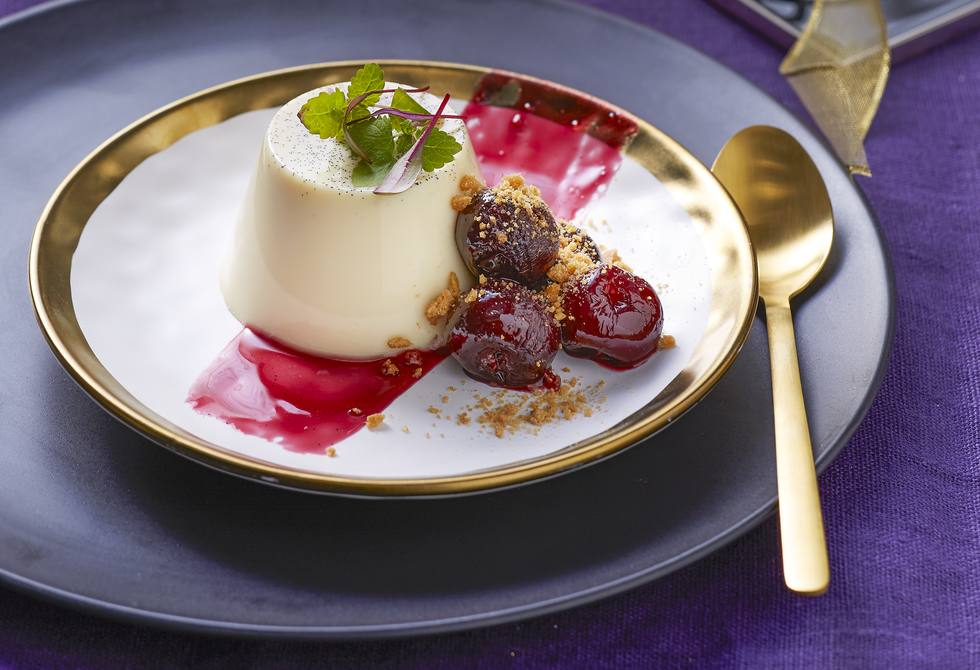 Panna cotta with drunken cherries and smashed gingernut crumbs