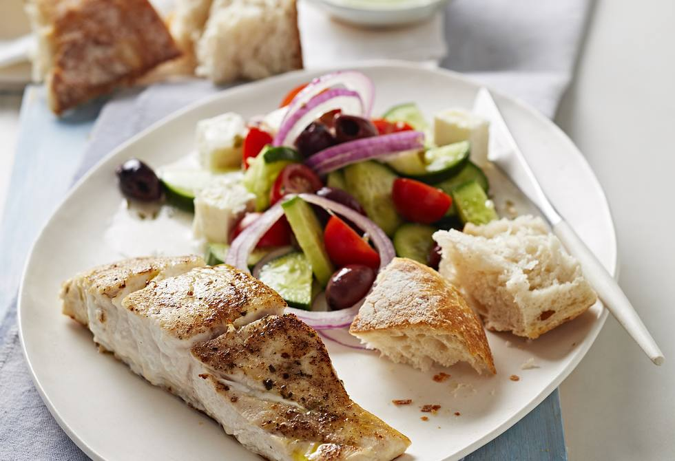 Pan-fried fish with Greek salad