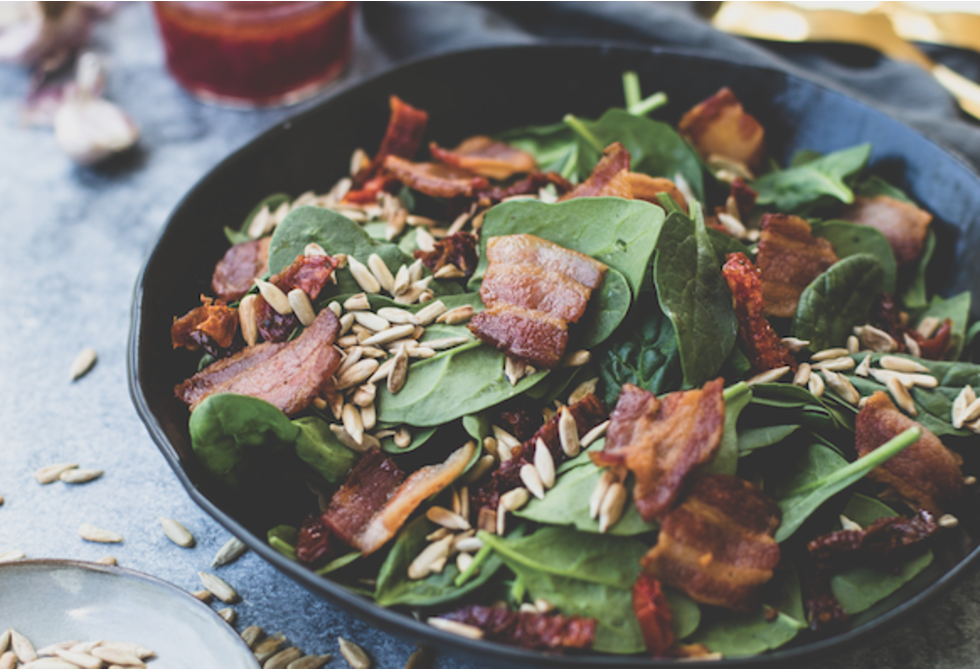 Spinach and sun-dried tomato salad with raspberry dressing