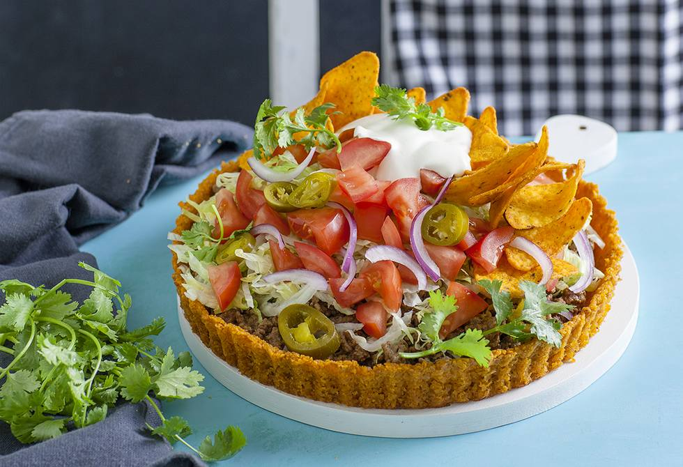Taco pie with cheesy corn chip crust