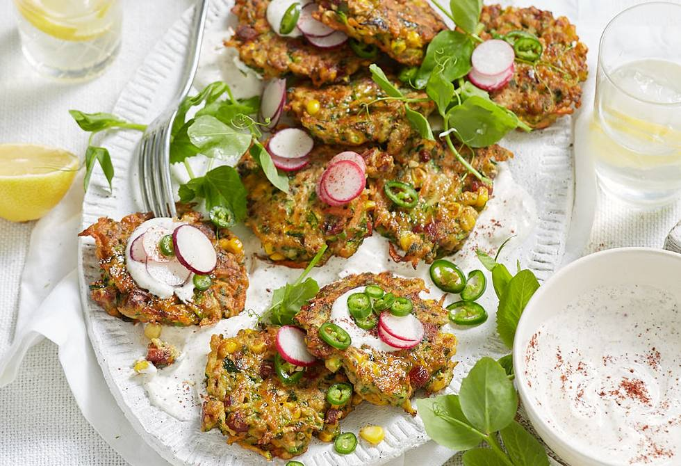 Spring vegetable and chorizo fritters with sumac yoghurt sauce