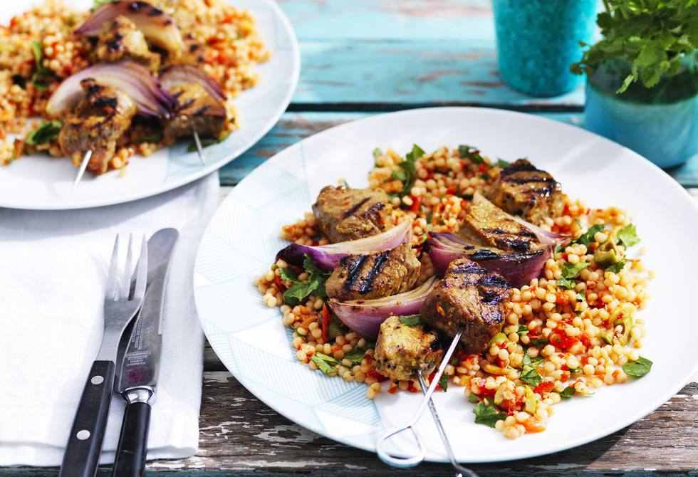 Moroccan beef skewers with capsicum, almond and olive couscous