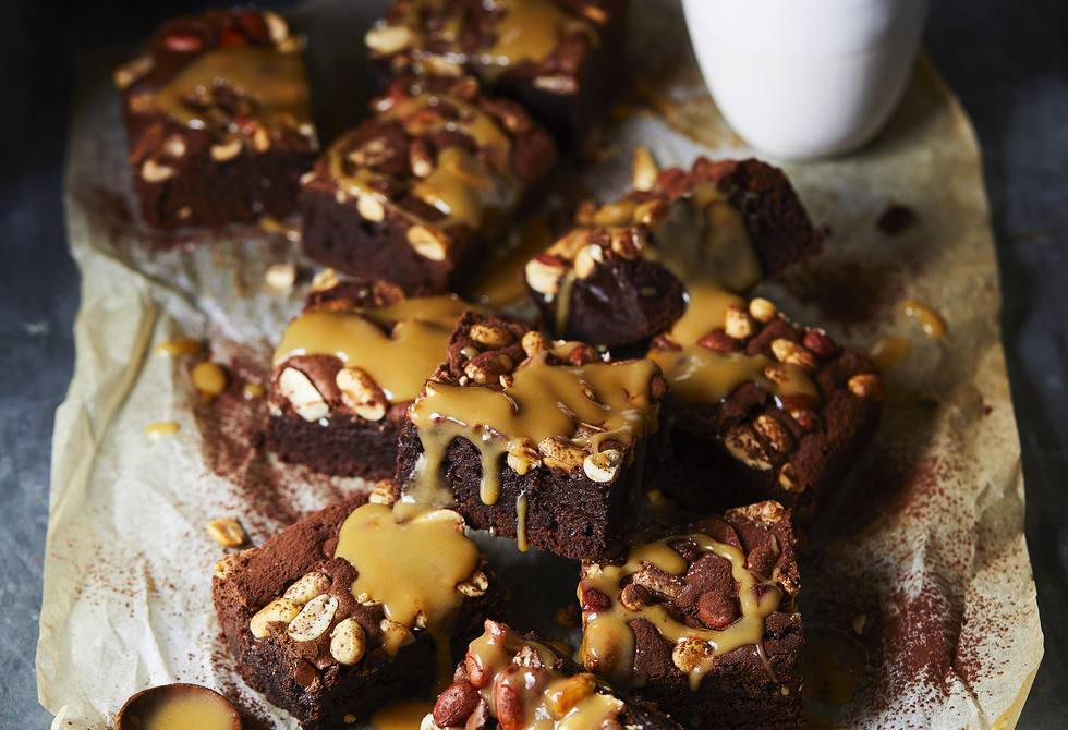 Chocolate, bourbon & peanut brownies with peanut caramel sauce