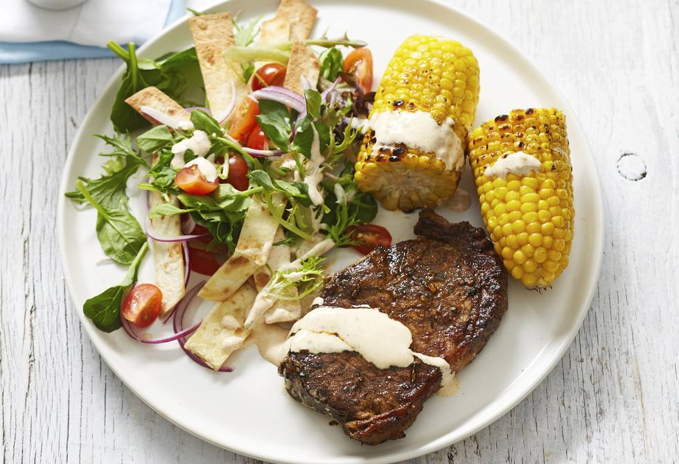 Mexican steak and corn with salad