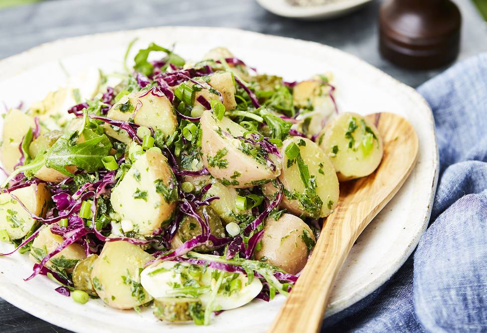Potato, pickled cucumber and rocket salad with basil dressing