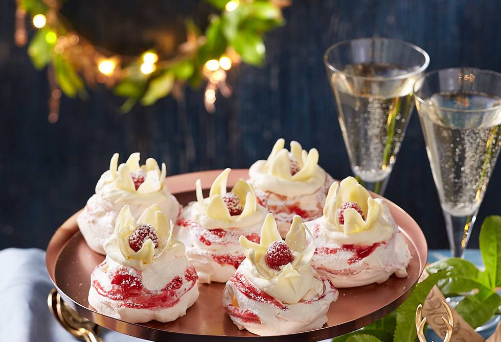 Passionfruit and raspberry pavlovas with white chocolate flowers