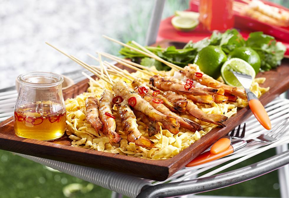 Skewered ginger and garlic prawns with chilli lime syrup