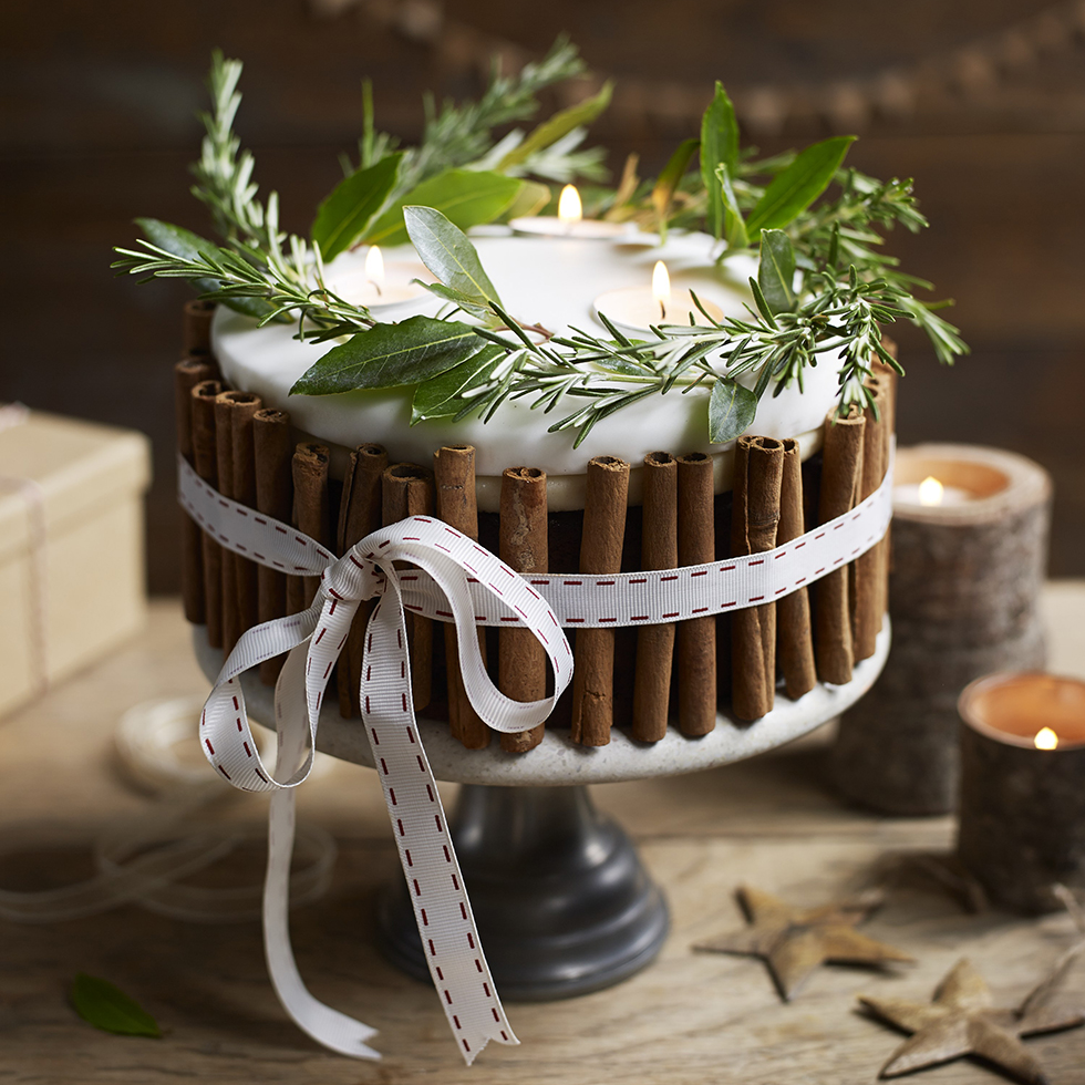 A candle cake is a simple way to bring the spirit of Christmas to your dining room.