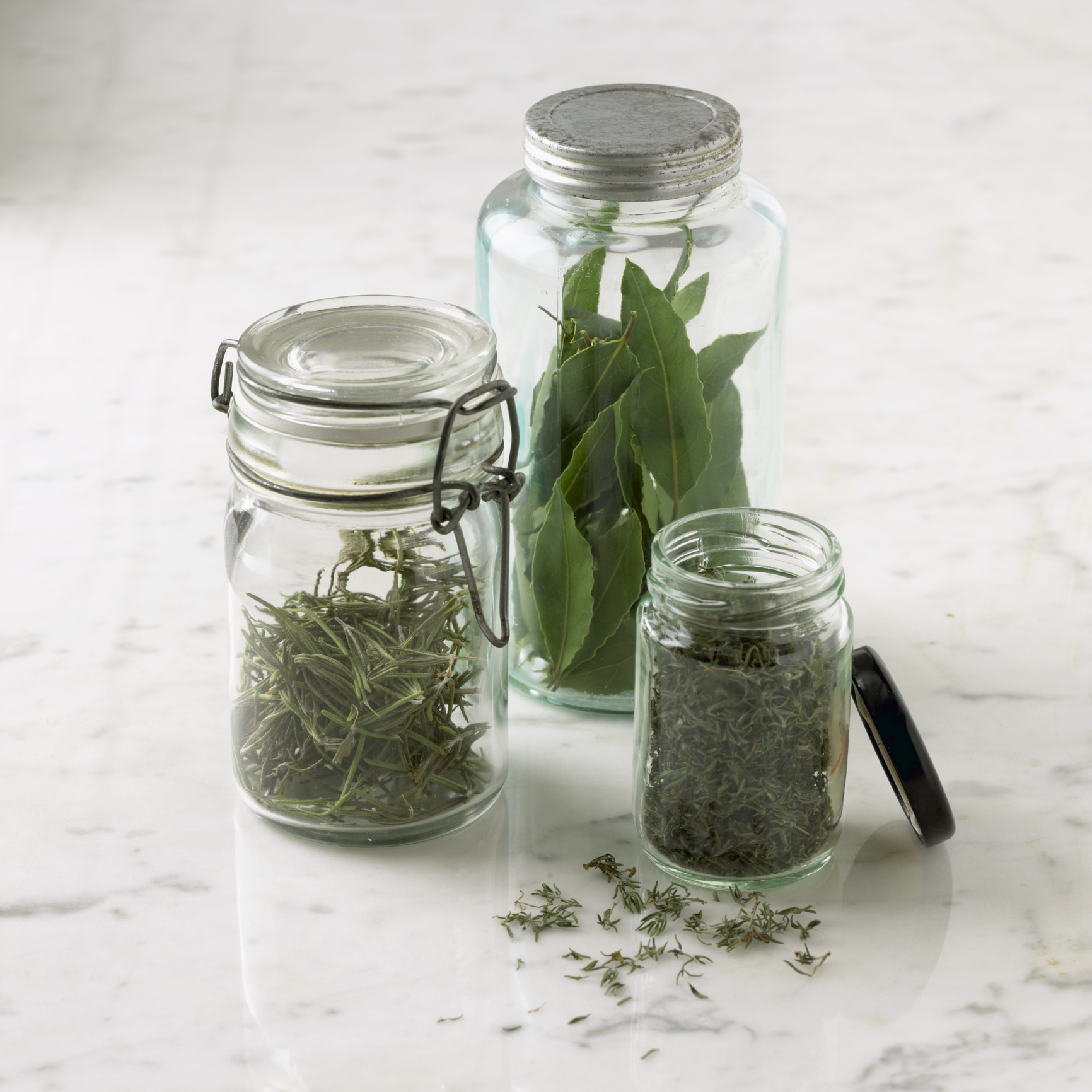 Dry fresh herbs in the microwave and keep them in an airtight jar. Photo credit: William Reavell / Getty Images.