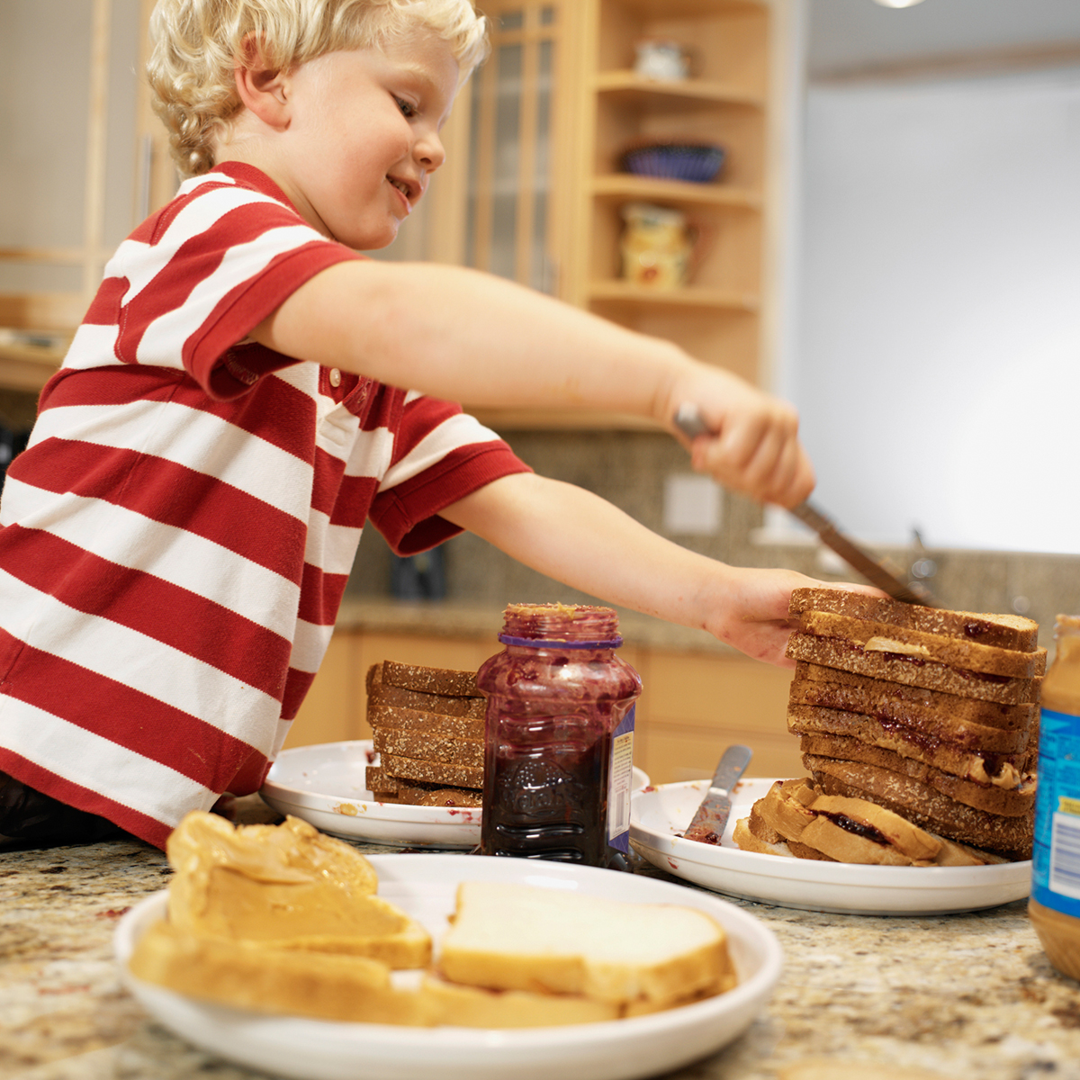 Get the kids to help with making lunch. Photo: White Packert/Getty Images