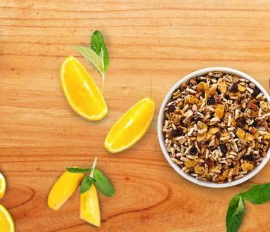 Copa de granola con naranjas y durazno