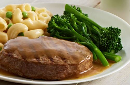 Steak with macaroni pasta and rich beef gravy