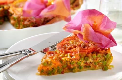 Tomaat-Pompoentaart met doperwtjes en spekjes