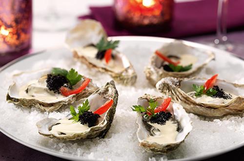 Warme oesters met Hollandaise-balsamicosaus