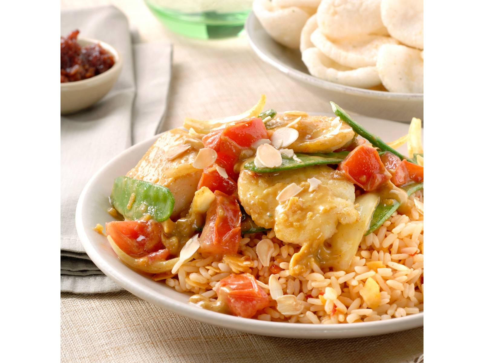 Indische vis en groentecurry met amandelrijst