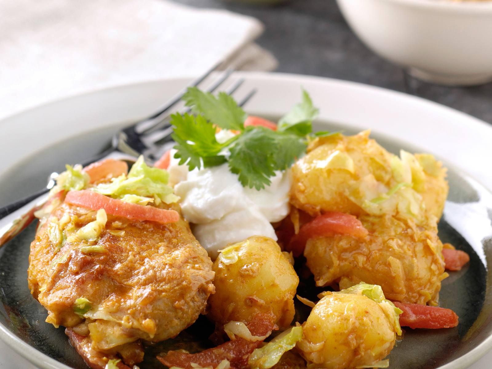Kerrie kip met krieltjes, tomaat en koriander