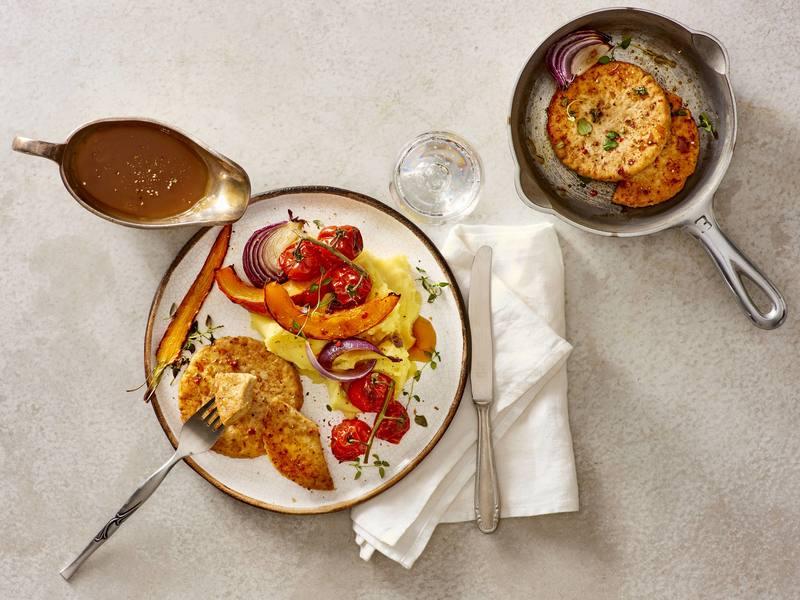 Bofkipburgers met aardappelpuree en ovengroenten