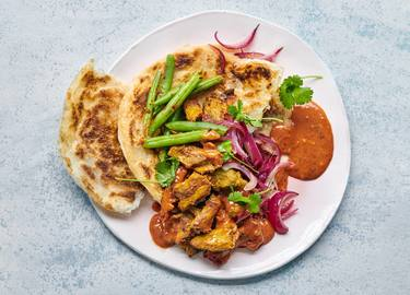 What the Cluck Curry with Roti