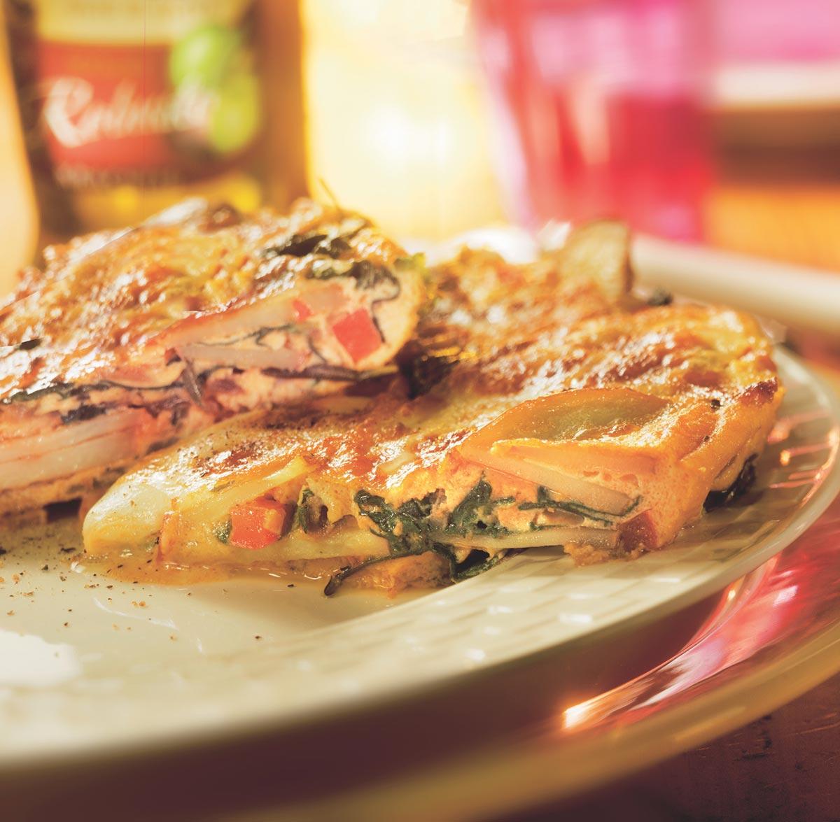 Winterse frittata met paprika, aardappels en pesto