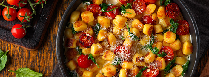 Gnocchi with Baby Tomatoes and Creamy Spinach Sauce
